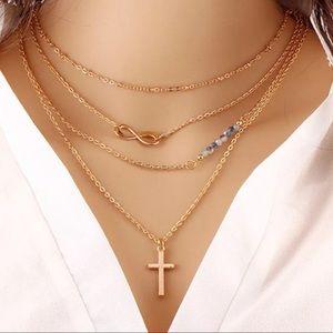 Jewelry - Four Layer Infinity Cross Necklace